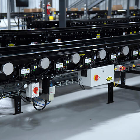 Roller belt conveyor powered by 24-volt motor ready to move materials.