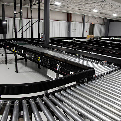 Horizontal conveyor powered by 24-volt motor ready to move materials.