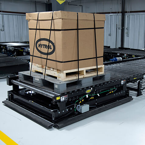 Pallets of products moved using chain driven live roller conveyors.