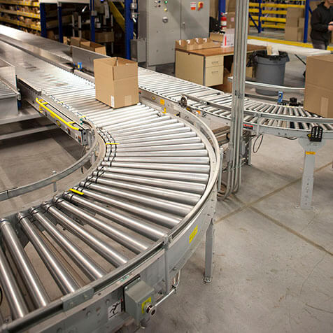 Box moves along gravity curve conveyor.