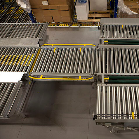 Conveyor gate allows passage for personel and equipment.