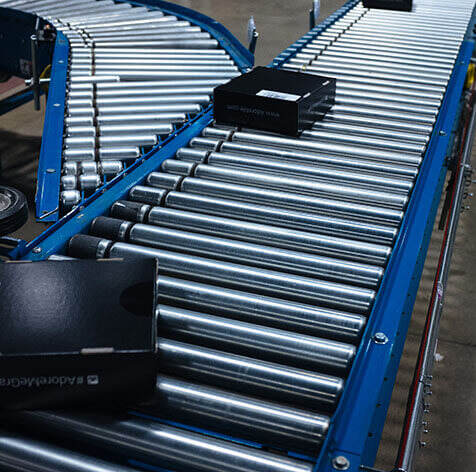 Live roller conveyor moving boxes.