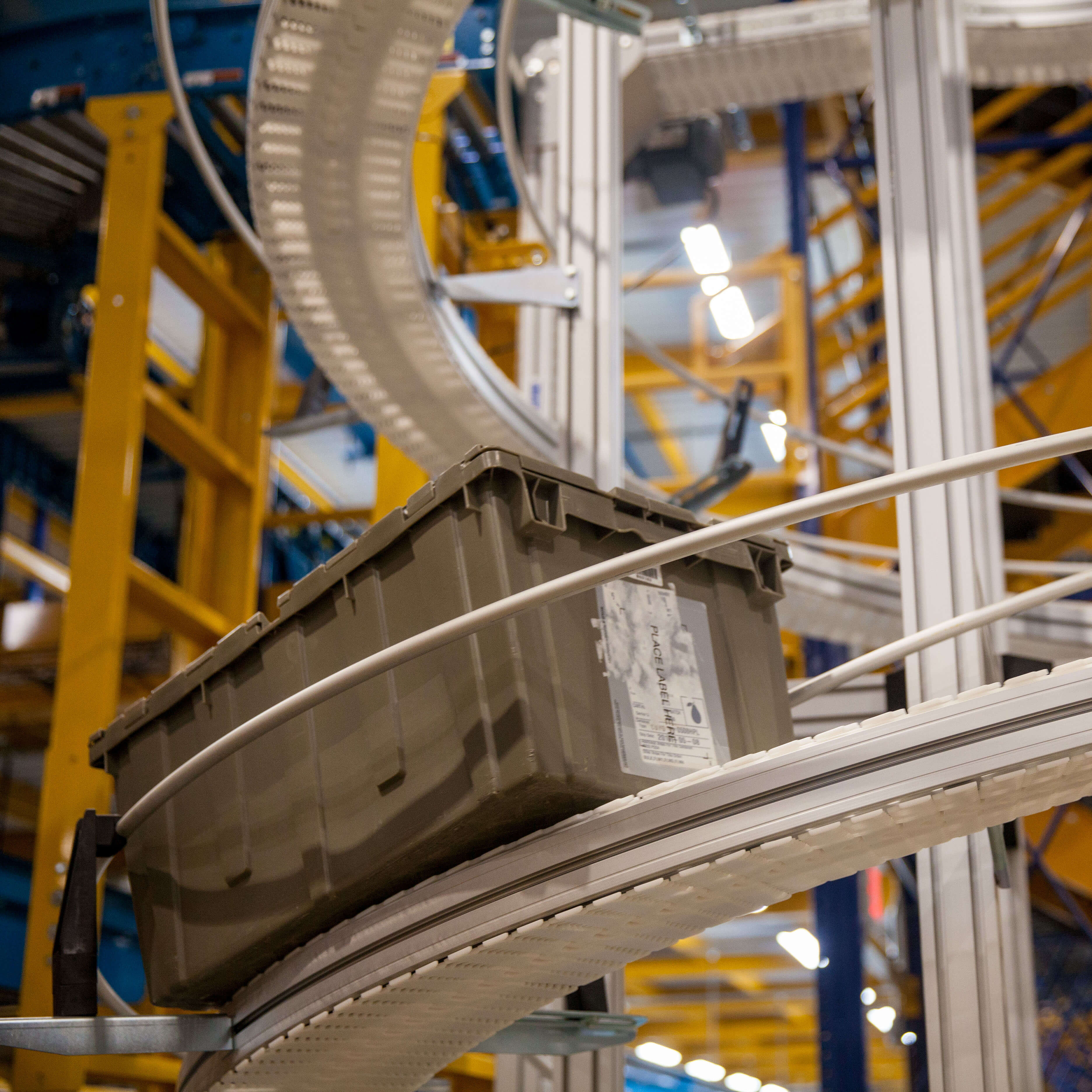 Plastic belt conveyor used to move plastic totes.