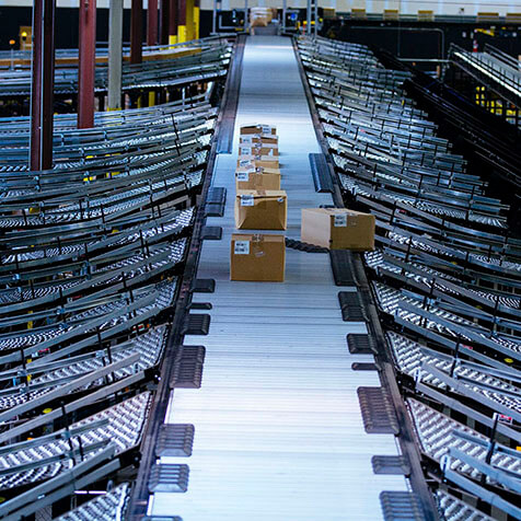 Products are gently diverted to appropriate areas via a shoe sliding across the conveyor.